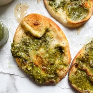 air fryer naan bread pizzas on white parchment paper