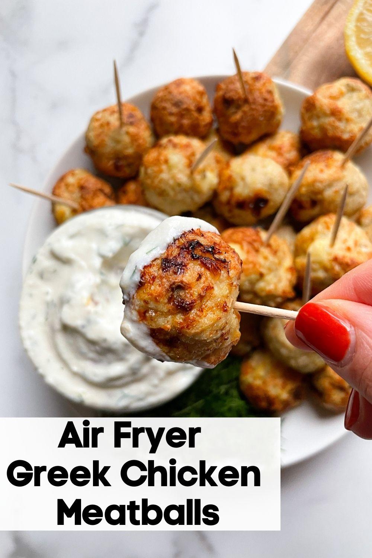 handing holding Air Fryer Greek Chicken Meatball on a stick