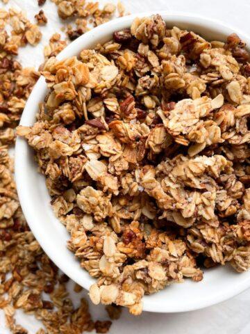 Healthy Maple Pecan Granola in white bowl
